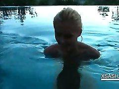 Splendid Sasha sucking hard balls and dick in pool
