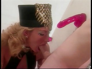 Cock loving Sophie Evans sucks dildo through glory hole