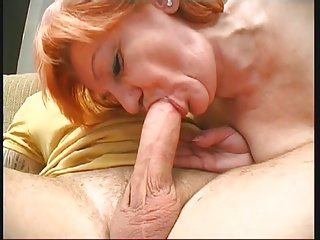 Granny sucks big white cock and pussy fucked on sofa